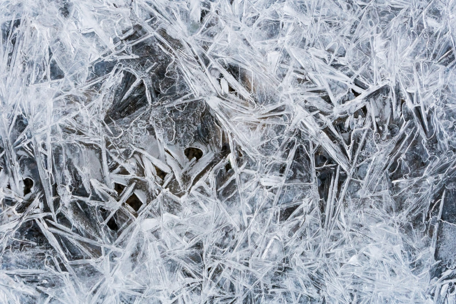 Abstract crystals of ice frozen pattern on warming planet