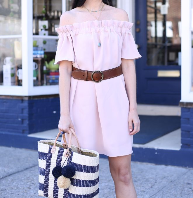 fashion blogger Anna Monteiro of Blushing Rose Style wearing pink dress from Nordstorm with a brown belt