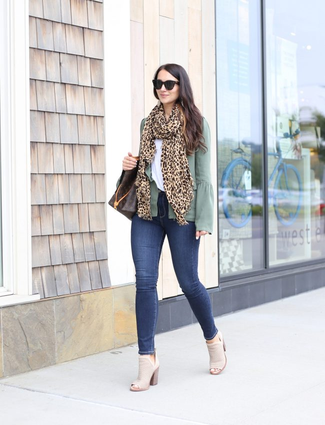 Anna Monteiro of blushing rose style wearing sole society leopard print scarf, halogen utility jacket and paige hoxton jeans from Nordstrom