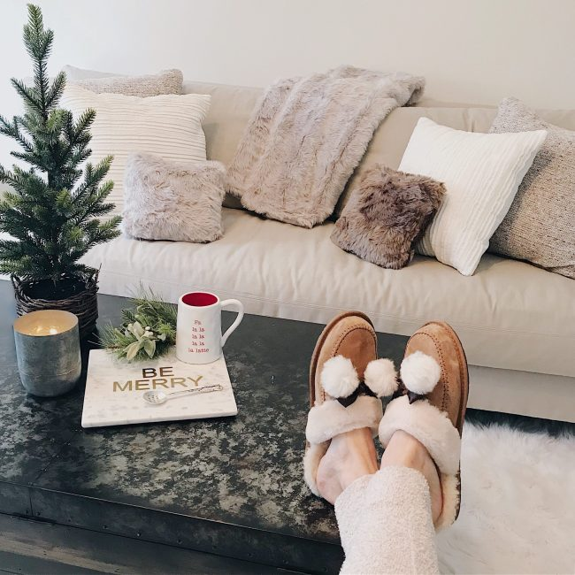 cozy holiday home decor faux fur pillows white couch and ugg slippers