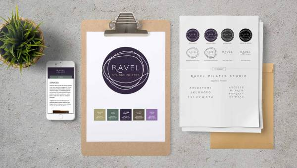 A clipboard with logo and color palette information for Ravel, showing some typical brand identity takeaways.