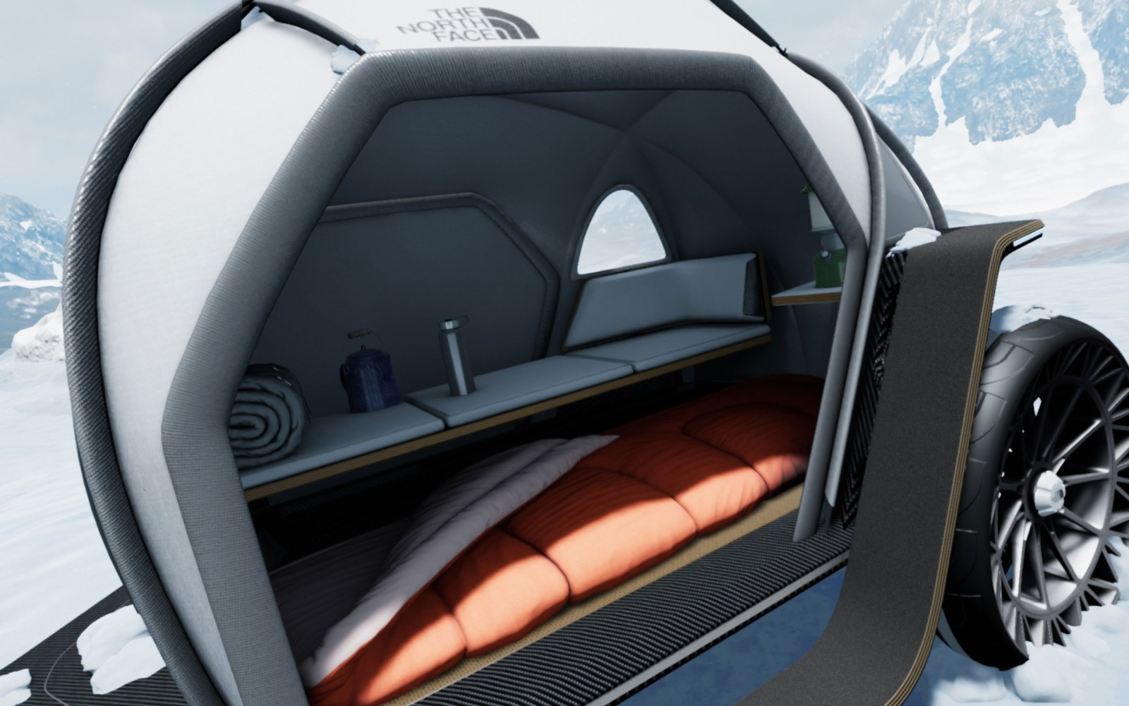 the north face camper interior with a bed and table