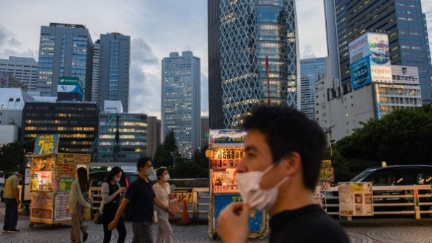 Evening commuters in the Shinjuku district of Tokyo, Japan, on Thursday, July 29, 2021. While the number of infections directly connected with the Olympics has so far been relatively low, Tokyo and its surrounding areas are experiencing their worst-yet virus wave.