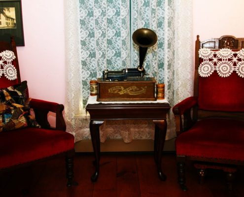 Two Victorian chairs with a phonograph