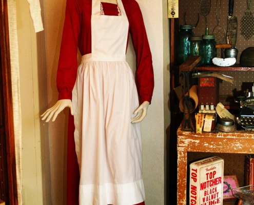 Mannequin wearing apron and cap