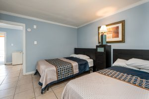 Bedroom of Suite with Full Kitchen at Oceanfront Hotel | Bordwalk Charlee Hotel