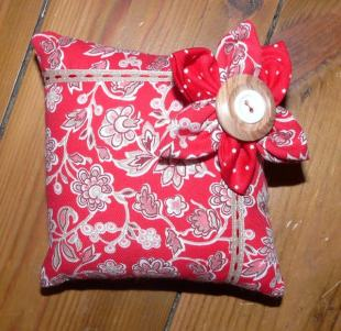 red pin cushion Bobbins and buttons