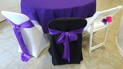 folding chair sashes boppy baby target bob b s party rentals covers left white spandex cover with a purple satin sash