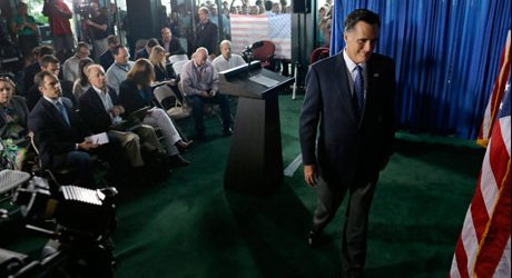 Mitt Romney smirking as he leaves press conference on Libya