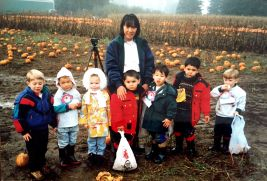 Feyma with school kids at the Pumpkin Patch