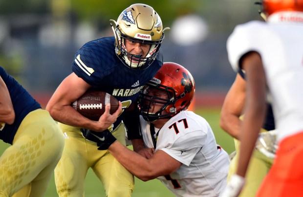 Frederick High School quarterback Jake Green ...