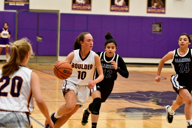 Boulder's Abbie Gillach drives in Monday's ...
