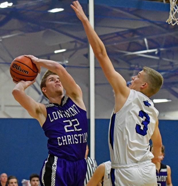Daniel Vrooman of the Longmont Christian boys basketball team