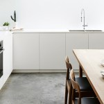 4 beautiful white kitchens with concrete floor
