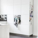 A white, open-plan living dutch family home