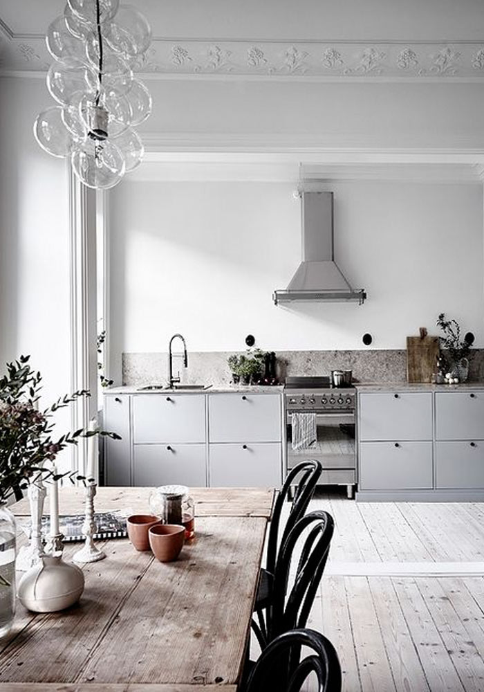 grey kitchen & white floorboards