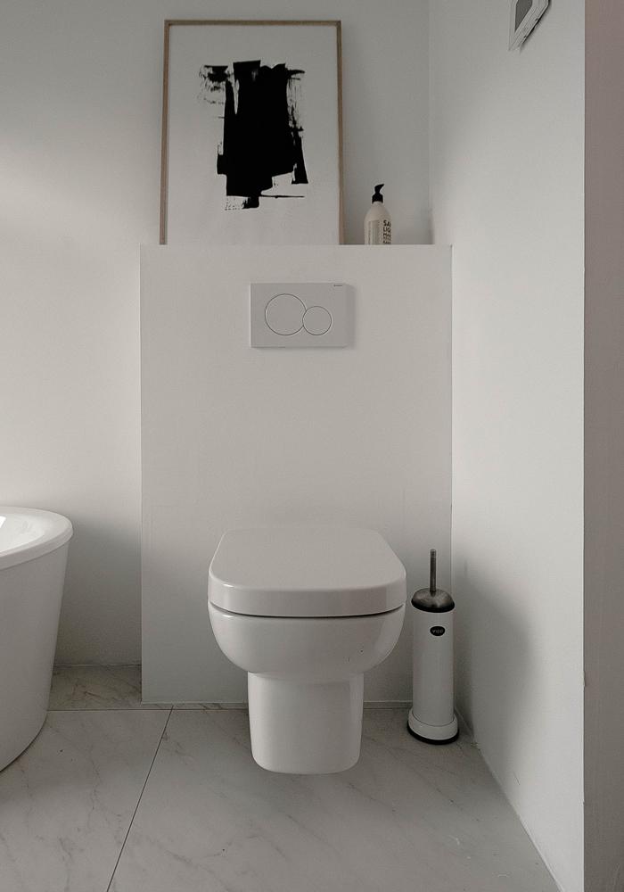 A white, minimalist bathroom makeover