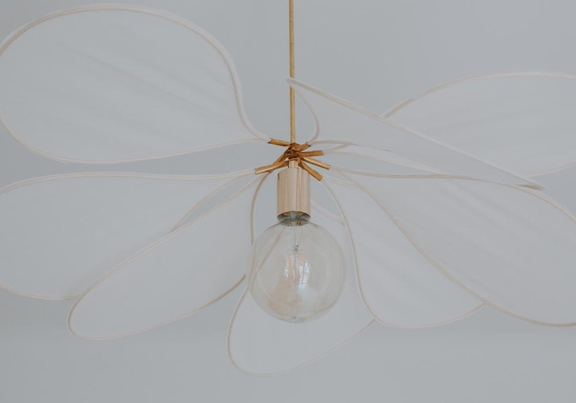 Suspension light used in a bedroom makeover with plywood