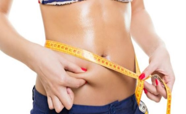 Performing Exercise That Targets To Remove Fat From Belly Region