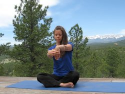 Wrist Flexor Stretch, palm facing body, with a view of Sangre de Cristo Mountains, Colorado