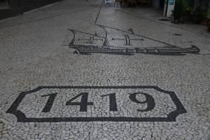 Mosaik im Gehsteig