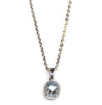 Checkerboard cut Aquamarine pendant (1.9 ct. total wt.), surround- ing diamond weight .65ct., 18″ 14 kt. white gold chain. $375