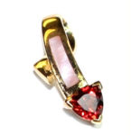 Heart-shaped Garnet and Pearl pendant (.2 total wt.) in a 14 kt. yellow gold setting. $225