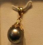 XXXBlack Pearl pendant with a 14kt. yellow gold setting. $195
