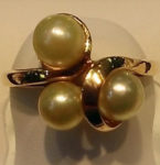 XXX3 Pearls (10ct.) clustered in a 14kt. yellow gold setting. Ring size 5.5 $185