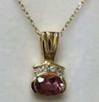 "XXXPink Tourmaline gemstone (.08 total wt.) pendant topped with 4 Diamonds, 18"" chain is 14 kt. yellow gold. $429"