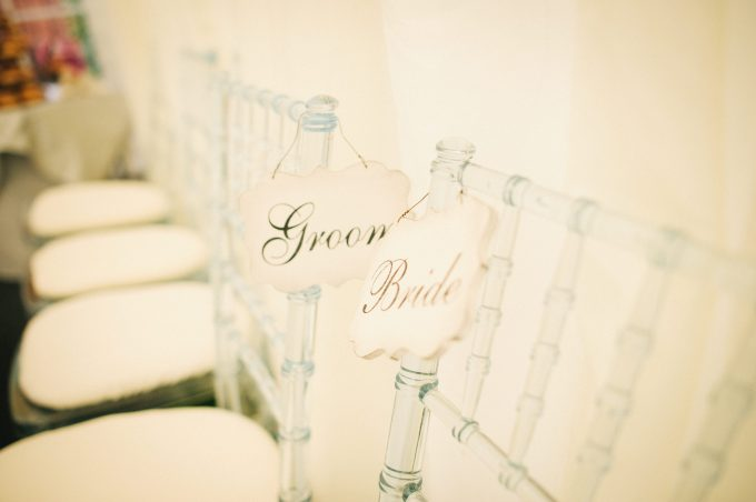 bride and groom signs on chair