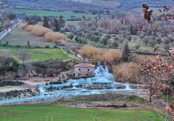 distant view of sartunia hot springs in tuscany