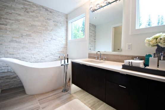 Livingstone ensuite completed with Wooden White Marble installed on the floor and backsplash. Fantasia Ledgestone is installed on the wall.