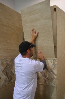 Classic Ivory Bolder Stone Panel being installed