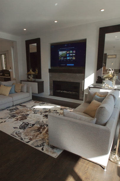 Persian Silver Bolder Stone Panel installed as a fireplace surround