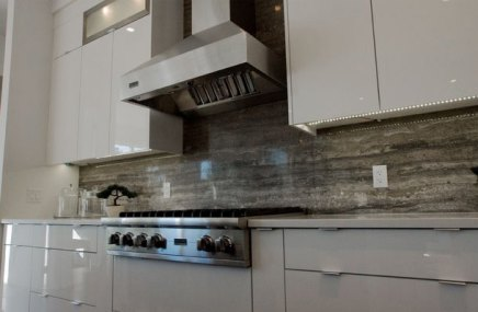 Persian Silver Bolder Stone Panel installed as a kitchen backsplash