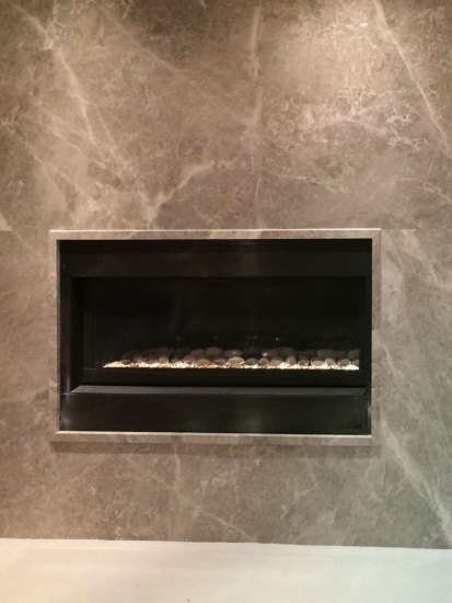 Silver Shadow Fireplace with matching moulding around fireplace insert