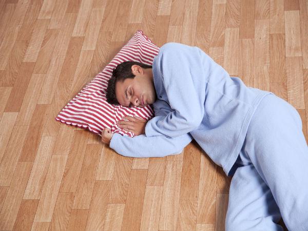 is sleeping on floor