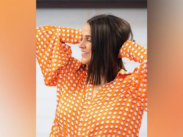 Neha Dhupia's Bright Orange Skirt Set