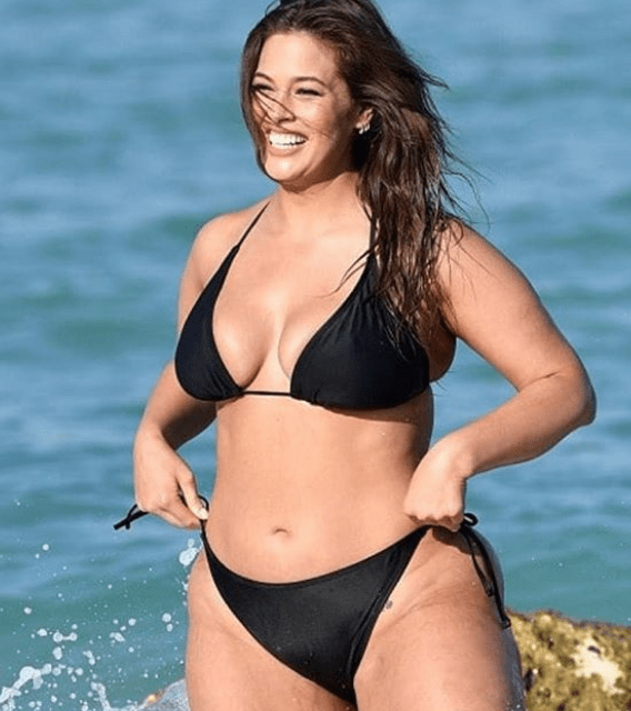 Bikini-clad Ashley Graham hits the beach for sexy swimsuit collection shoot