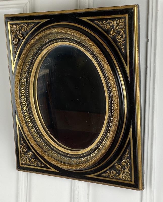 miroir glace ovale epoque napoleon iii en bois noirci et or