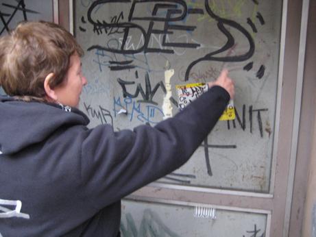 Martha Cooper collecting street art sticker