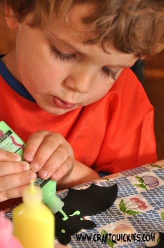 Painting glow in the dark bats is a fun Halloween activity for kids!