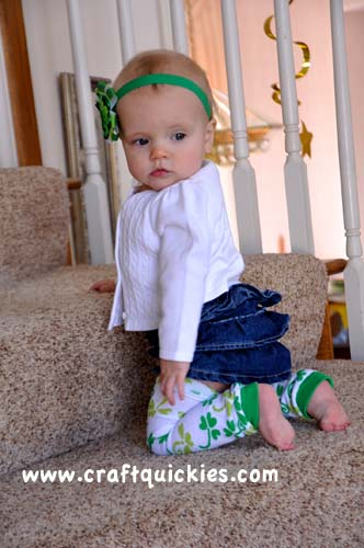 baby wearing baby leg warmers on stairs