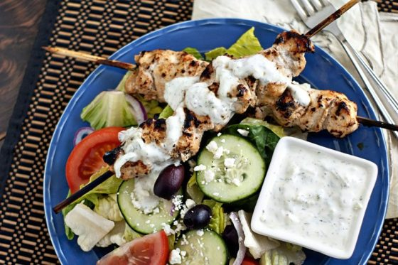 grilling grilled chicken tzatziki salad on blue plate