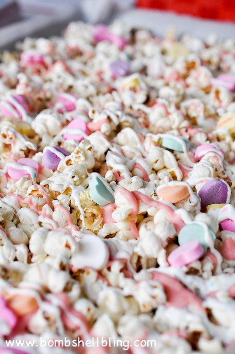 Make conversation heart popcorn for Valentine's Day with this simple recipe! This is perfect for a Valentine's Day party or as a gift for a loved one!