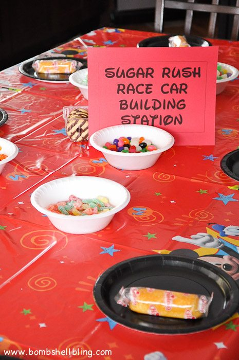 Make race cars from candy and cookies for a fun Wreck It Ralph party!