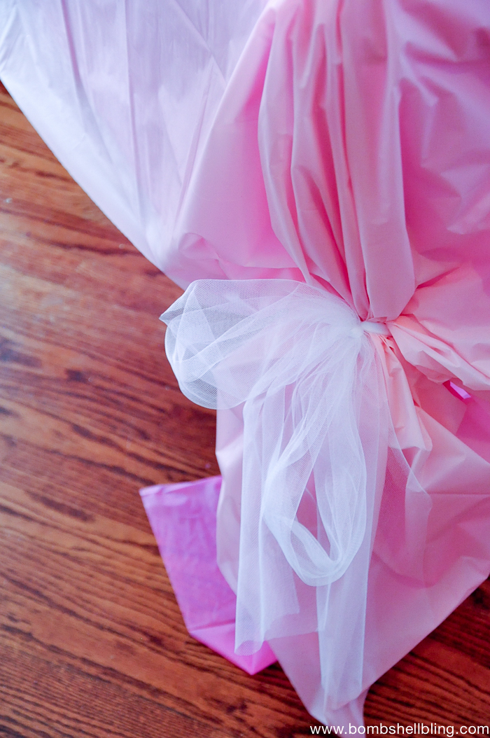 Tie up plastic tablecloths with tulle - so fancy and quick for a party!