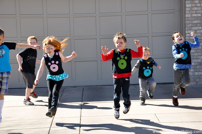 Kids jumping in driveway at Wild Kratts Birthday Party