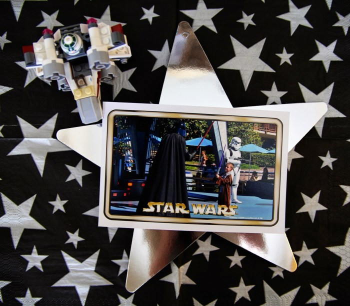 Star Wars Lego table centerpiece photo on silver star next to mini lego figure
